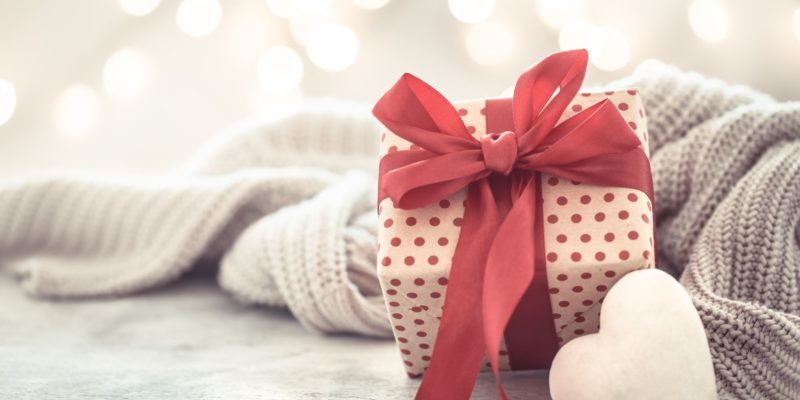 Background holiday, gift in a beautiful box with a heart . Valentine's day. The concept of love and relationships.